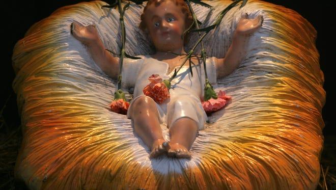 Baby Jesus rests in his manger.