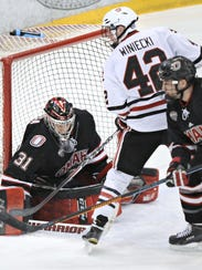 St. Cloud State's Blake Winiecki tries to score past