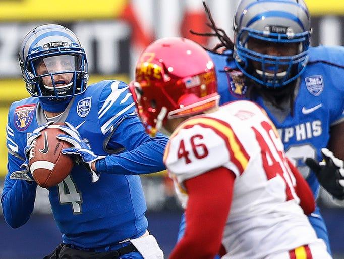Memphis quarterback Riley Ferguson (left) looks for