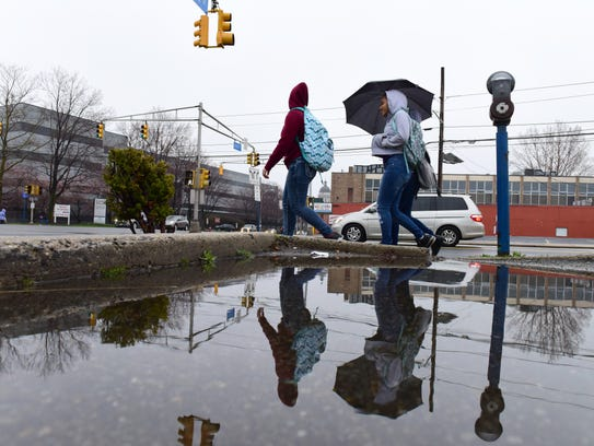 Women walk along State Street in Hackensack Tuesday