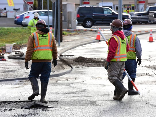 Contractors at a water main break just off Route 17 in Hasbrouck Heights.