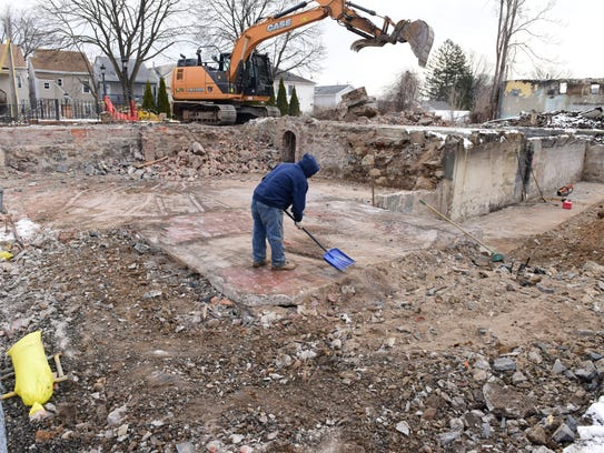 A worker at the site of the former Casa di Calabria restaurant, also known as the Piedmont, in Haledon.