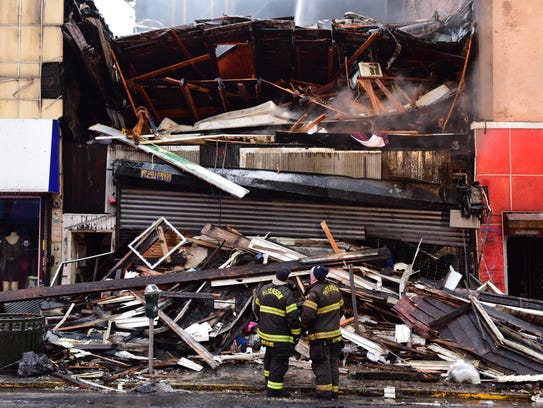 Paterson firefighters are still pouring water on a