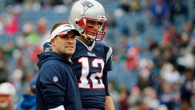 New England Patriots offensive coordinator Josh McDaniels and quarterback Tom Brady have put together a strong offense this season.