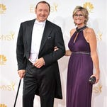 Kevin Spacey, left, and Ashleigh Banfield arrive at the 66th Annual Primetime Emmy Awards at the Nokia Theatre L.A. Live on Monday in Los Angeles.