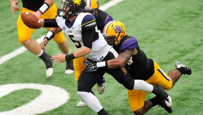 Hardin-Simmons linebacker Cory Ward hits East Texas Baptist quarterback Dru Smith (5) as he throws during the second quarter of the Cowboys' 66-30 win on Saturday, Nov. 5, 2016, at HSU's Shelton Stadium.