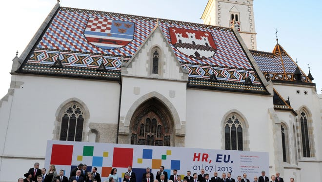 Officials pose at St. Mark church in Zagreb. The Croatian Catholic Church has found a priest guilty of pedophilia for the first time.