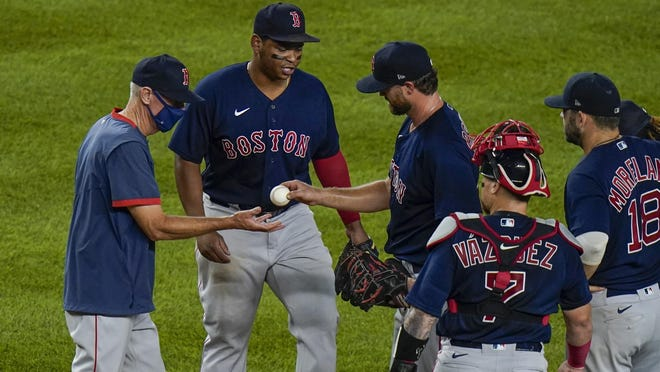 Red Sox manager Ron Roenicke has worn out a path to the pitcher's mound this season. Here he takes the ball from reliever  Colten Brewer in the third inning of Friday night's game against the Yankees. New York won, 10-3, handing Boston its fifth straight loss.