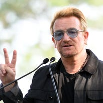 Bono greets fans before rehearsal for concert in Turin, Italy, on Sept. 1, 2015.