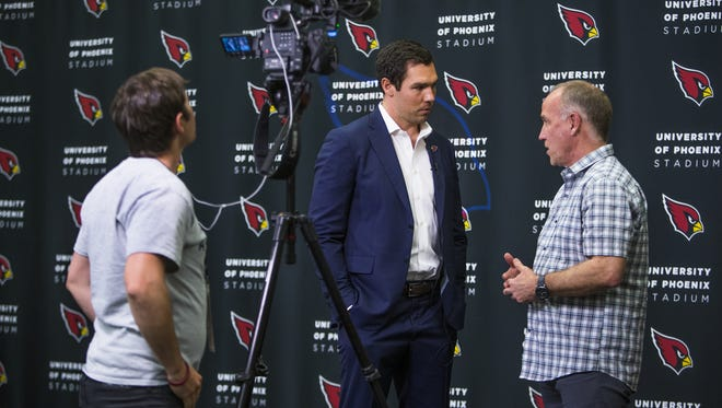 Newly-signed Arizona Cardinals quarterback Sam Bradford is interviewed by azcentral sports videographer Sean Logan, left, and Cardinals insider Kent Somers at the training facility in Tempe, Friday, March 16, 2018.
