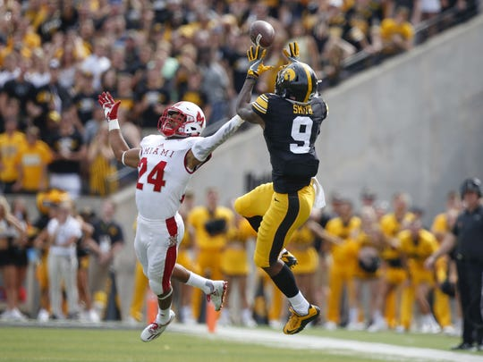 Iowa receiver Jerminic Smith goes up to make a reception against Miami (Ohio) on Saturday, Sept. 3, 2016, at Kinnick Stadium in Iowa City.