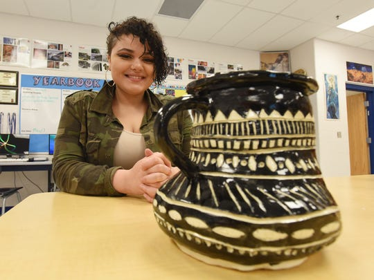 Annalise Tobias, a junior at Zanesville High School, with her Greek pottery. The piece is being displayed at the Muskingum County K-12 Student Art Exhibition starting this weekend.