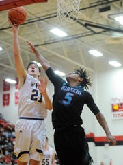 Wylie's Dylan Isenhower (21) takes a shot over Hirschi's