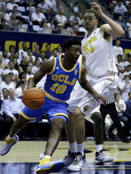 UCLA's Isaac Hamilton, left, drives the ball around California's Kameron Rooks (44) during the first half of an NCAA college basketball game Thursday, Feb. 25, 2016, in Berkeley, Calif. (AP Photo/Ben Margot)