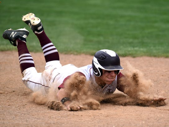 Score Perkins dives into third base during the fifth