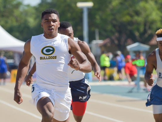 Raymond Calais in lane 5 for the boys 100 meter dash