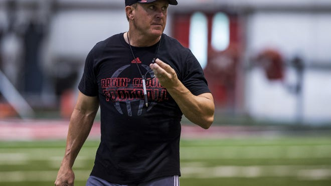 Paul Kieu/The Advertiser UL head coach Mark Hudspeth exercises during a recent camp session at the Moncla Indoor Practice Facility in Lafayette. Paul Kieu/The Advertiser UL head coach Mark Hudspeth said heâ??s concerned about the defenseâ??s lack of live tackling in preparation for the season opener at Kentucky. UL head coach Mark Hudspeth conducts special teams exercises during a fall camp session at the Moncla Indoor Practice Facility in Lafayette, LA, Tuesday, Aug. 11, 2015.
