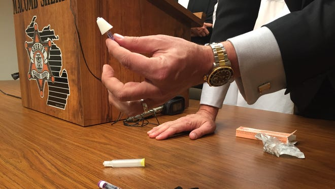 Closeup of the opioid overdose prevention kit that Macomb County Sheriff's deputies started carrying this month to save someone in the throes of an overdose, shown during a news conference May 27, 2015 at the sheriff's office in Mt. Clemens.