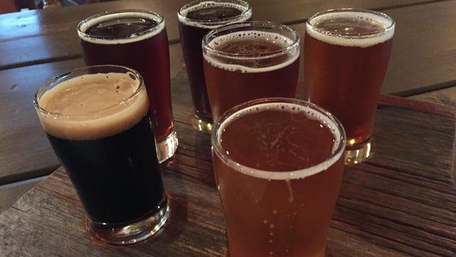 A beer flight of Spilled Grain Brewhouse beers .