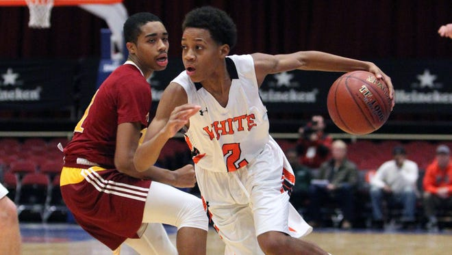 White Plains' Eisaiah Murphy drives past Cardinal Hayes' Jaelen Nesmith during their championship game of the Slam Dunk Tournament at the Westchester County Center Dec. 27, 2016.