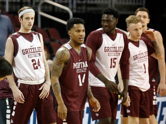 Montana's Ahmaad Rorie (14), shown in a 2018 photo with his teammates, is headed back to the NCAA Tournament after the Grizzlies beat Eastern Washington 68-62 for the Big Sky Conference Championship. (AP Photo/Orlin Wagner)