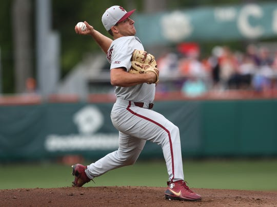 FSU's Drew Parrish pitches during their game at Doug
