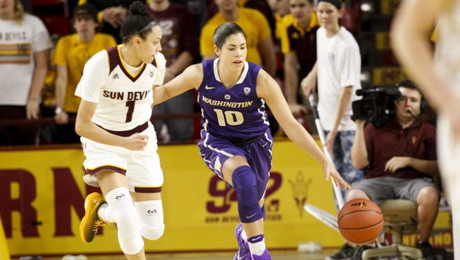 Washington senior guard Kelsey Plum (10) brings the ball up the court as ASU freshman guard Reili Richardson (1) defends in the first half at Wells Fargo Arena in Tempe on Sunday, Jan. 15, 2017.