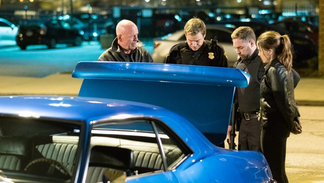 """Bruce Willis (left) and Sophia Bush star in """"Acts of Violence."""""""
