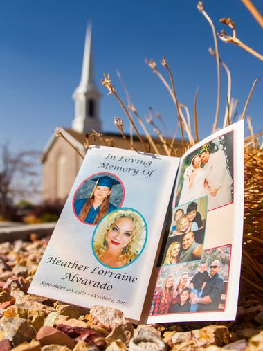 A program for Heather Alvarado's funeral sits outside