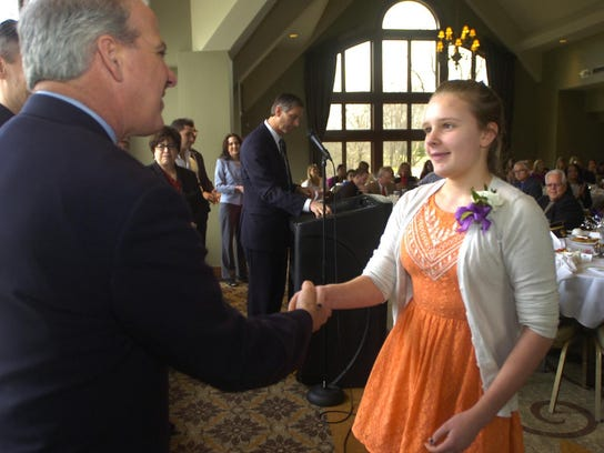 Cassidy Pakkala of East Middle School shakes hands
