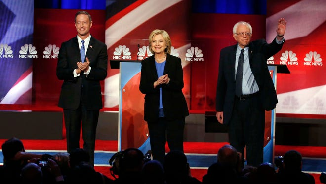 Democratic presidential candidates, former Maryland Gov. Martin O'Malley, Hillary Clinton and Sen. Bernie Sanders, I-Vt,  stand together before the start of the Democratic presidential debate.