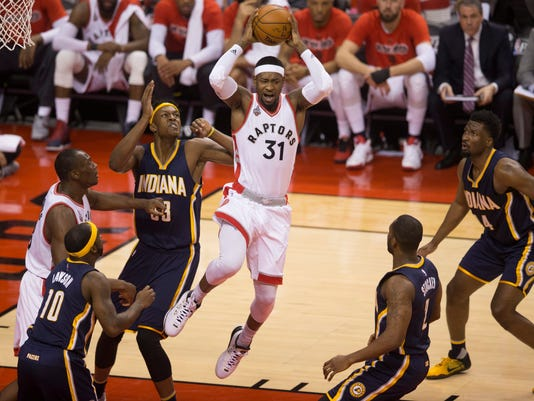Toronto Raptors' Terrence Ross, 31, takes control of the ball against the Indiana Pacers during first half, round one NBA basketball playoff action in Toronto on Monday, April 18, 2016. (Mark Blinch/The Canadian Press via AP) MANDATORY CREDIT
