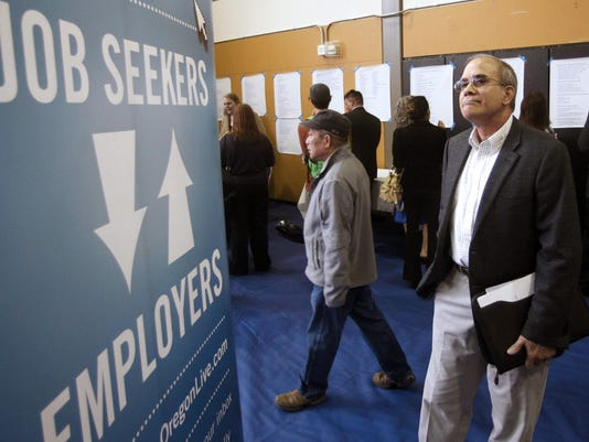 -JOBS_signwalkers_AP12.jpg_20130702.jpg