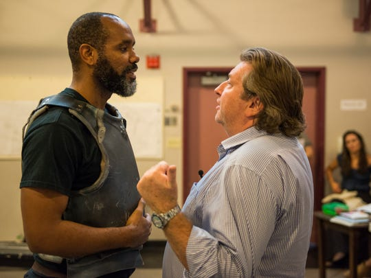 """Nathaniel Stampley (left) and director Mark Clements discuss the possibility of giants during a rehearsal for """"Man of La Mancha."""""""