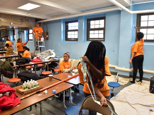 Students and other volunteers paint the walls of the Demarest Elementary School cafeteria as a part of Dr. Martin Luther King Jr. Day of Service in Bloomfield on Saturday, Jan. 13, 2018.