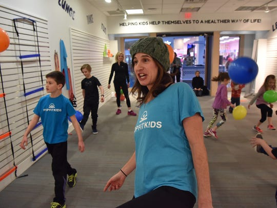 PopFit Kids founder Mara Wedeck trains with kids at