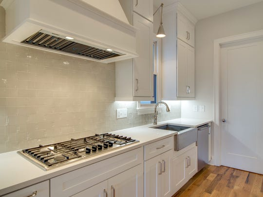 "The gourmet kitchen in Carbine's new Lone Oak property in Green Hills uses the high-end Walker Zanger ""Otto Oxford"" backsplash."