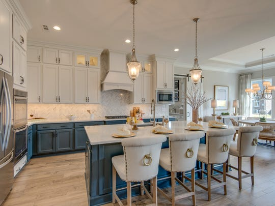Model homes are staged to help buyers imagine what it would be like to live there. This is the interior of Drees Homes' model in Hendersonville's Durham Farms community.