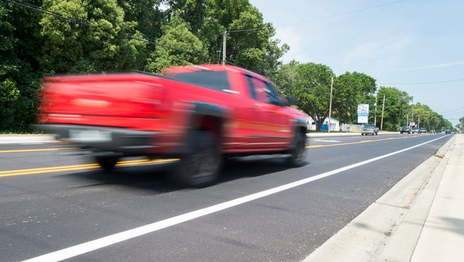 Traffic flows unimpeded by construction along East Olive Road in Pensacola on Wednesday, May 9, 2018.  Escambia County has finished the first phase of the Olive Road widening project.