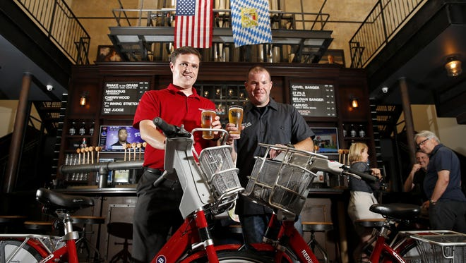 Taft's Ale House head brewer Kevin Moreland, right, and Cincinnati Red Bike executive director Jason Barron, left, are collaborating on a commemorative beer, celebrating Red Bike's first anniversary. The two will also host a big event at the brewpub Sept. 15.