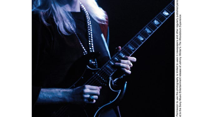Johnny Winter peforms at Woodstock.