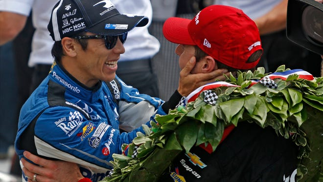 2017 winner Takuma Sato congratulates Will Power after he won  the 102nd running of the Indianapolis 500 at Indianapolis Motor Speedway on Sunday, May 27, 2018.