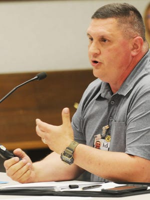 Jason Tiller, Salina County Health Department director, advances the slide as he gives a COVID-19 update to the Saline County Commission during a meeting in the City-County building in June.