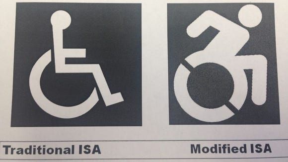 The new sign portrays a person in a wheelchair in motion.