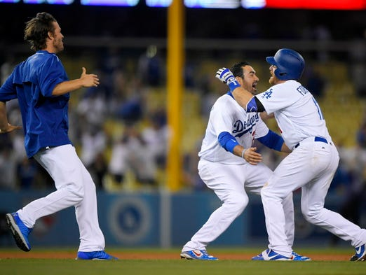 May 23: The Los Angeles Dodgers' Logan Forsythe (right)