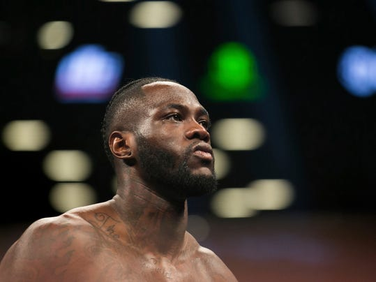 FILE - In this Nov. 4, 2017, file photo, Deontay Wilder paces the ring before a boxing bout against Bermane Stiverne, for the WBC heavyweight title, New York. Wilder has big plans. They don't particularly include Luis Ortiz, against whom Wilder defends his  WBC heavyweight title on Saturday night, March 3, 2018. (AP Photo/Kevin Hagen, File)