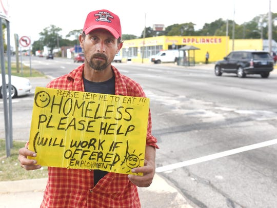 Matthew asks motorists for assistance at Eight Mile