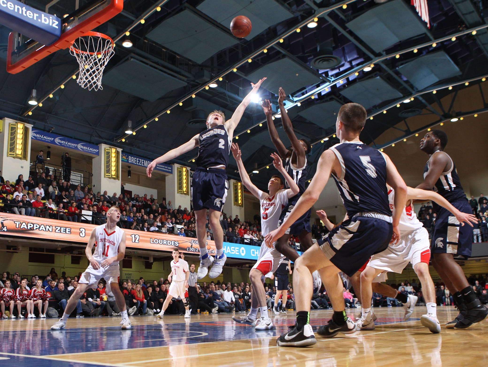 Lourdes' Joe Heavey (2) leaps for a rebound during their 42-38 win over Tappan Zee in the Section 1 Class A boys championship basketball game at the Westchester County Center in White Plains on Sunday, March 5, 2017.