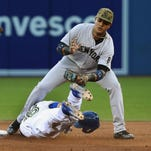 New York Yankees' Jacoby Ellsbury safely steals second base beating the tag by Toronto Blue Jays' Ryan Goins during the third inning of a baseball game in Toronto on Monday, May 30, 2016.