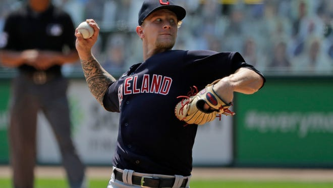 Cleveland Indians starting pitcher Zach Plesac throws against the Chicago White Sox during the first inning of a baseball game in Chicago, Saturday, Aug. 8, 2020.